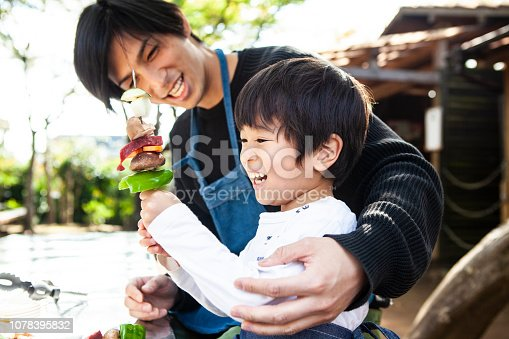 Father and son are making fun barbecue items