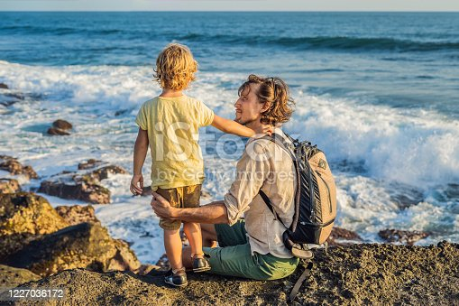 929671306 istock photo Father and son are walking along the cosmic Bali beach.. Portrait travel tourists - dad with kids. Positive human emotions, active lifestyles. Happy young family on sea beach 1227036172