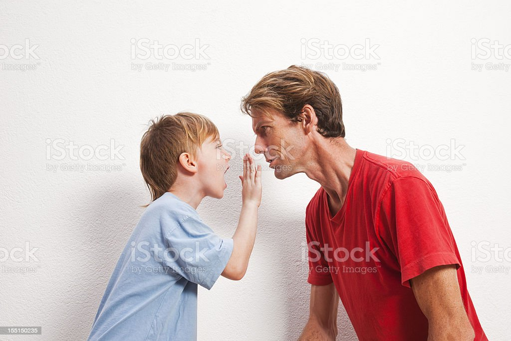 Father and son arguing stock photo