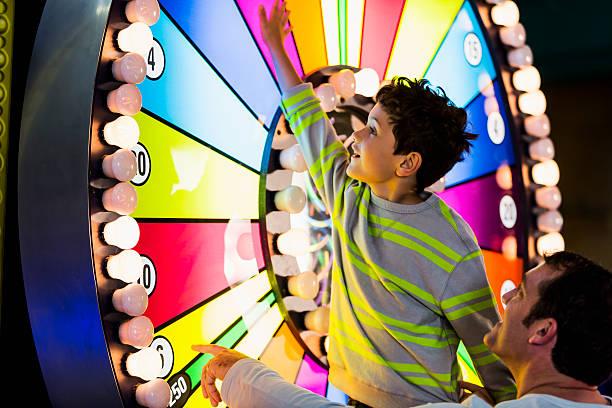 Father and son at an amusement arcade picture id509757805?b=1&k=6&m=509757805&s=612x612&w=0&h=eaassy6shsciqnalu bjafogx wgybusokpektprp o=