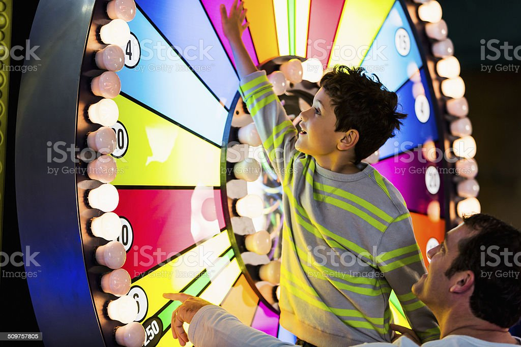 Father and son at an amusement arcade stock photo