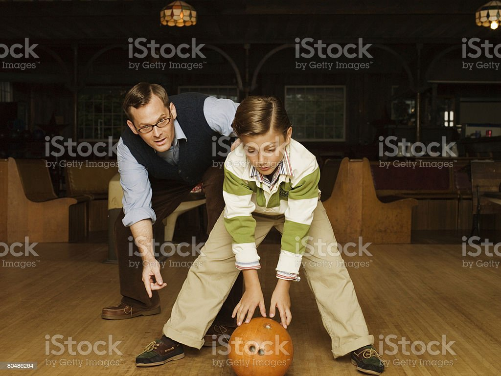 Father and son at bowling alley 免版稅 stock photo