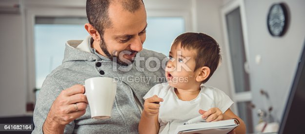 istock Father and son at home 641682164