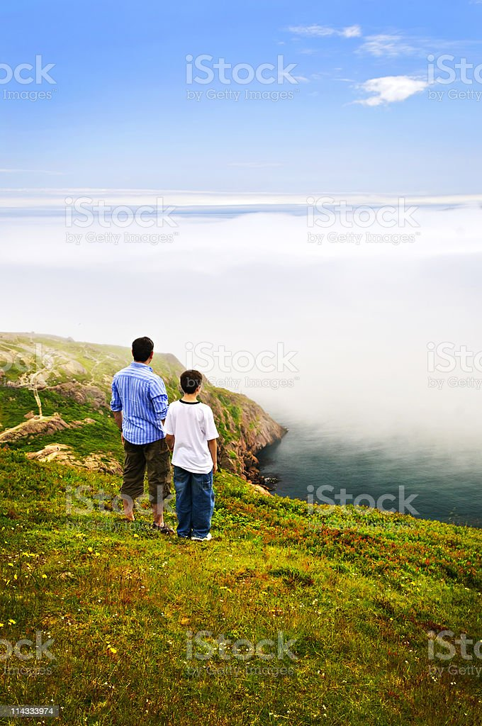 Father and son at ocean coast royalty-free stock photo