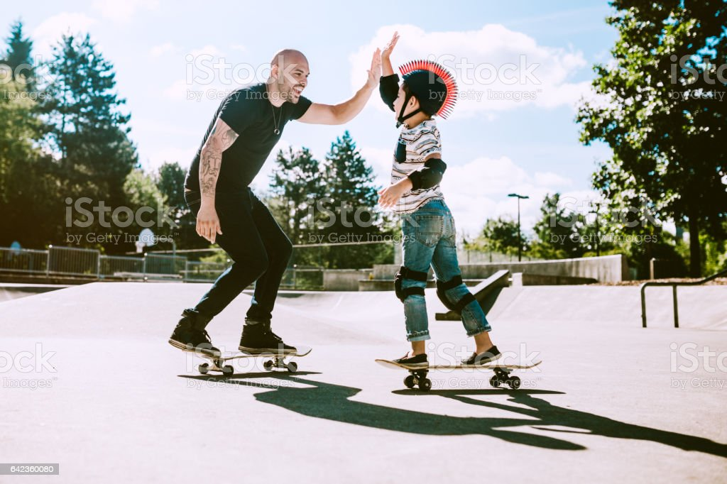 Father and Son at Skateboard Park stock photo