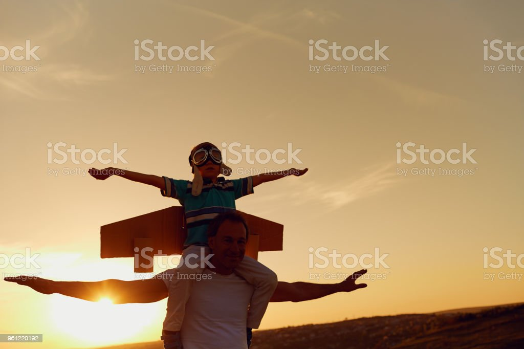 Father and son  at sunset in natur stock photo