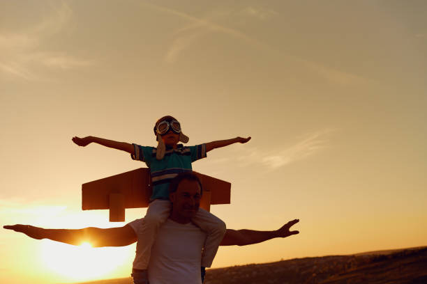 father and son  at sunset in natur - fathers day stock photos and pictures