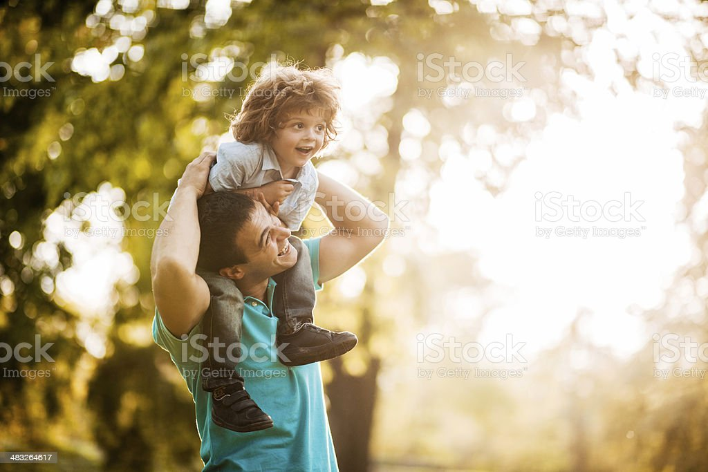 Father and son at sunset. stock photo