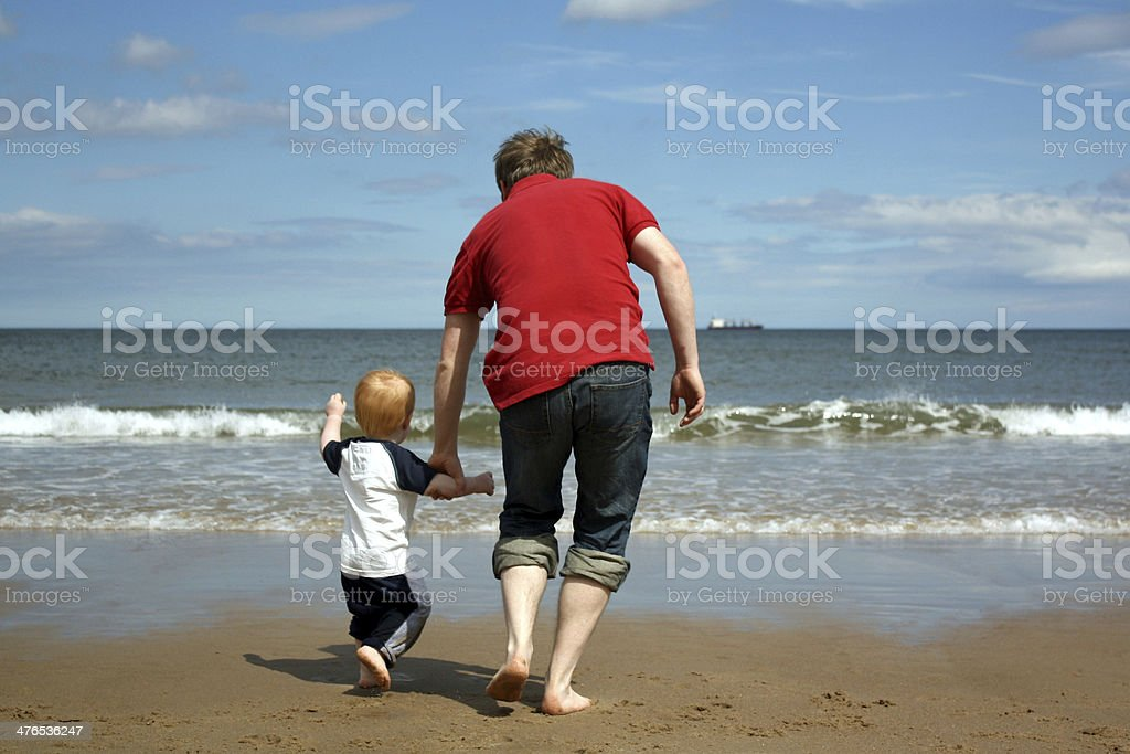 Father and Son at the Beach royalty-free stock photo