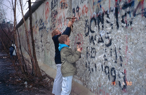 Father and son at the former Berlin Wall