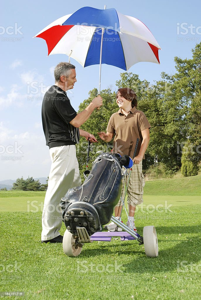Father and son at the golf course royalty-free stock photo