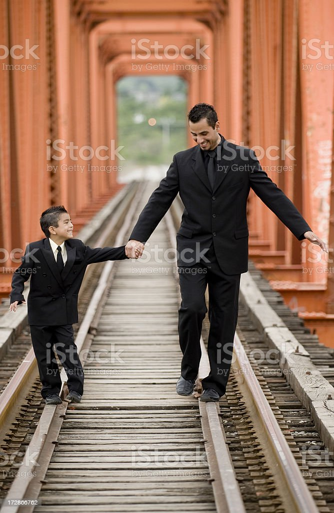 Father and son balancing royalty-free stock photo