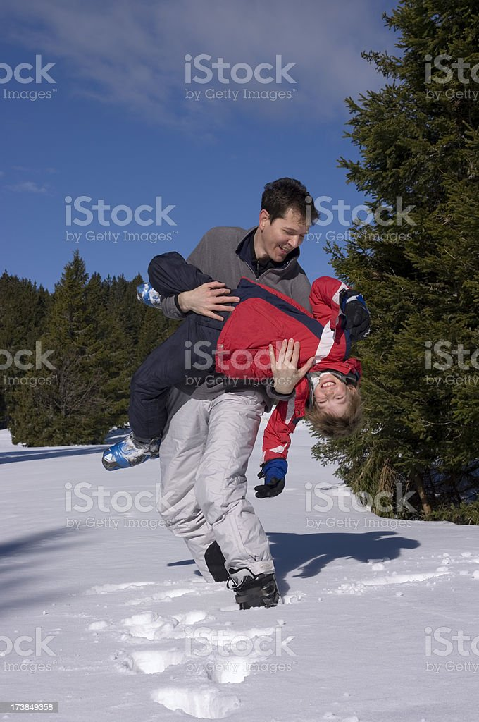 Father and son - beautiful winter day royalty-free stock photo