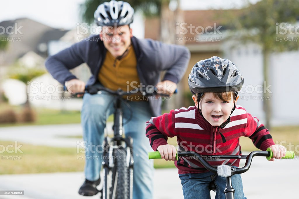 Father and son biking stock photo