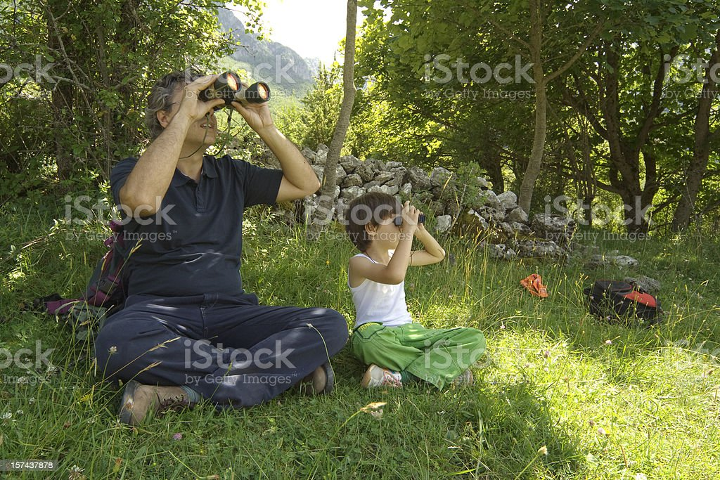 Father and son birdwatching in Abruzzo, Italy royalty-free stock photo