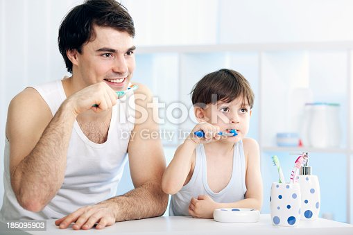 185211538istockphoto Father and son brushing teeth together 185095903