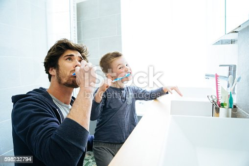 istock Father And Son Brushing Their Teeth 598232794