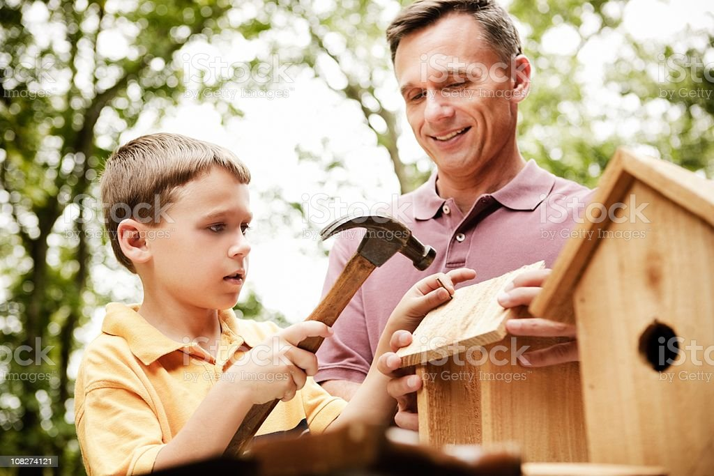 Father and Son Building Birdhouse stock photo