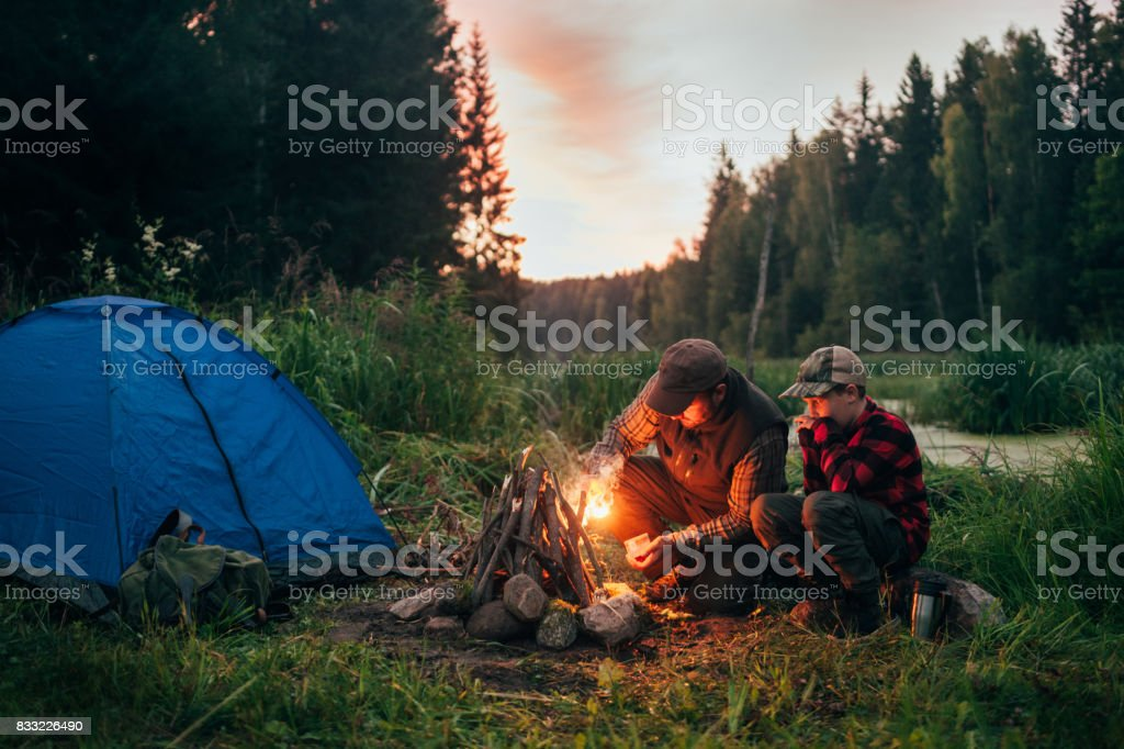 Father and son camping together stock photo