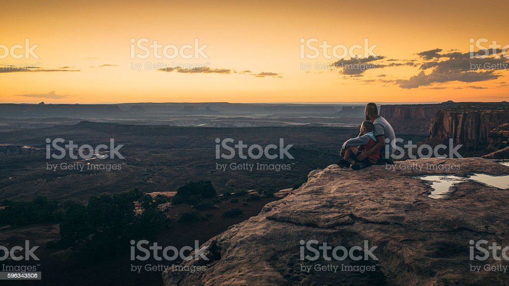 Father and son Canyonlands moment. stock photo