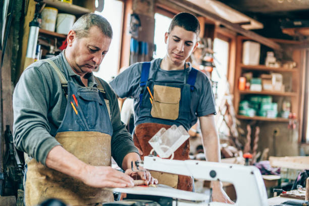 father and son carpenters - violetastoimenova stock photos and pictures