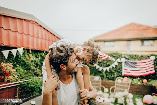 Photo of father and son celebrating Fourth of July in their yard