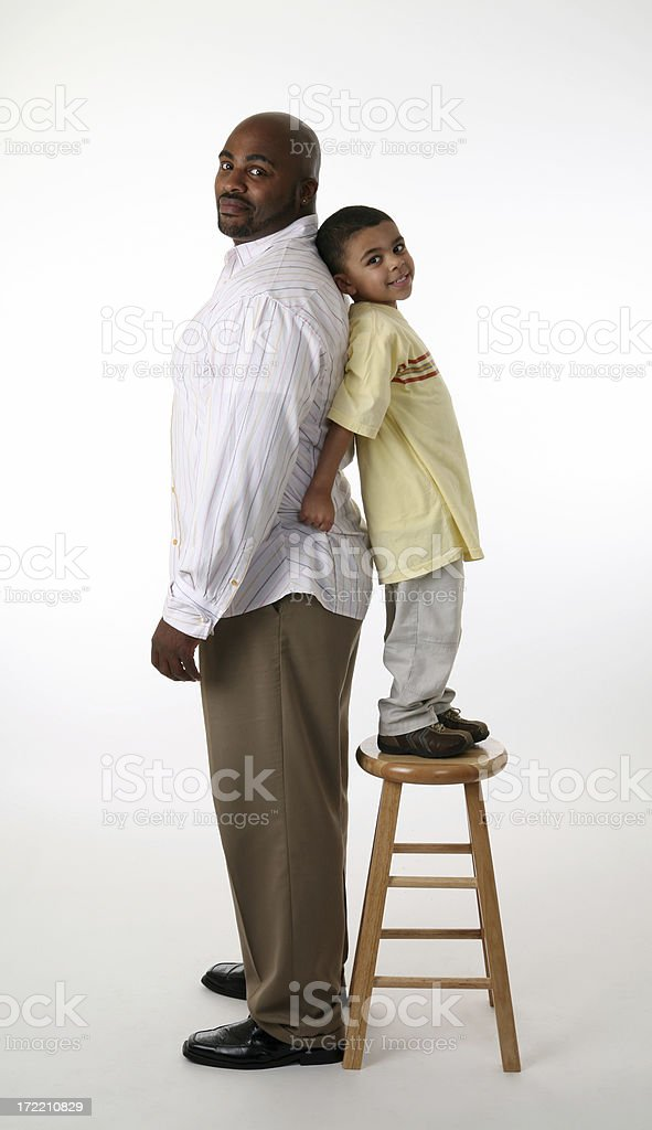 Father and son compare height stock photo