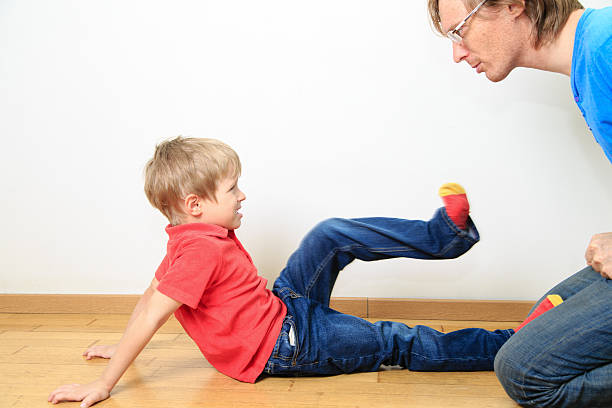 father and son conflict - aggression stock photos and pictures