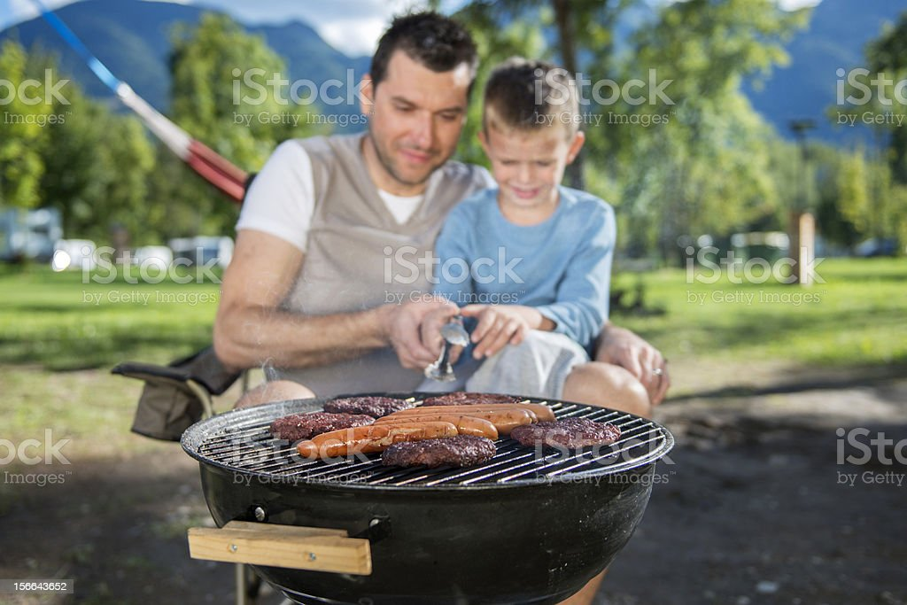 Father and son cooking together royalty-free stock photo