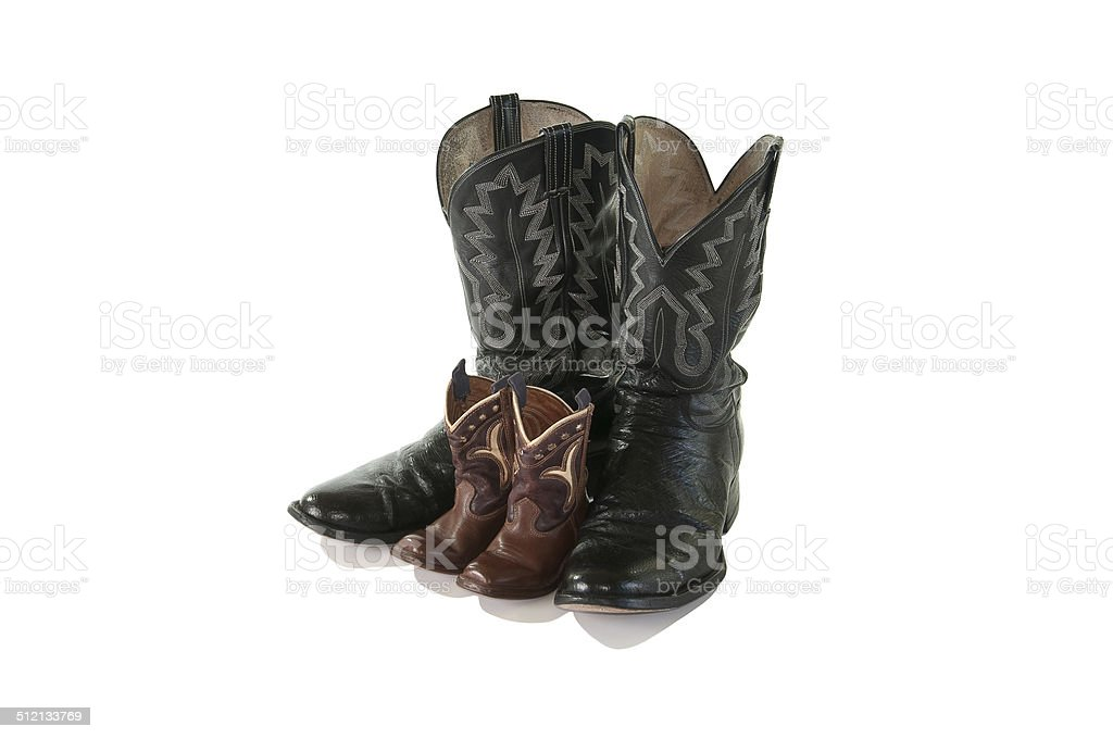 Father and Son cowboy boots - isolated stock photo