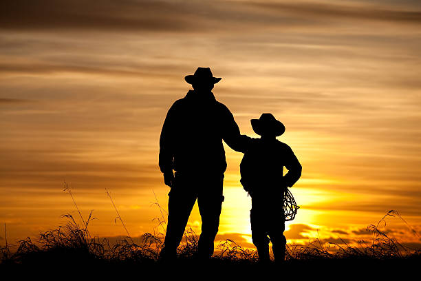 Father and Son Cowboy Silhouette stock photo