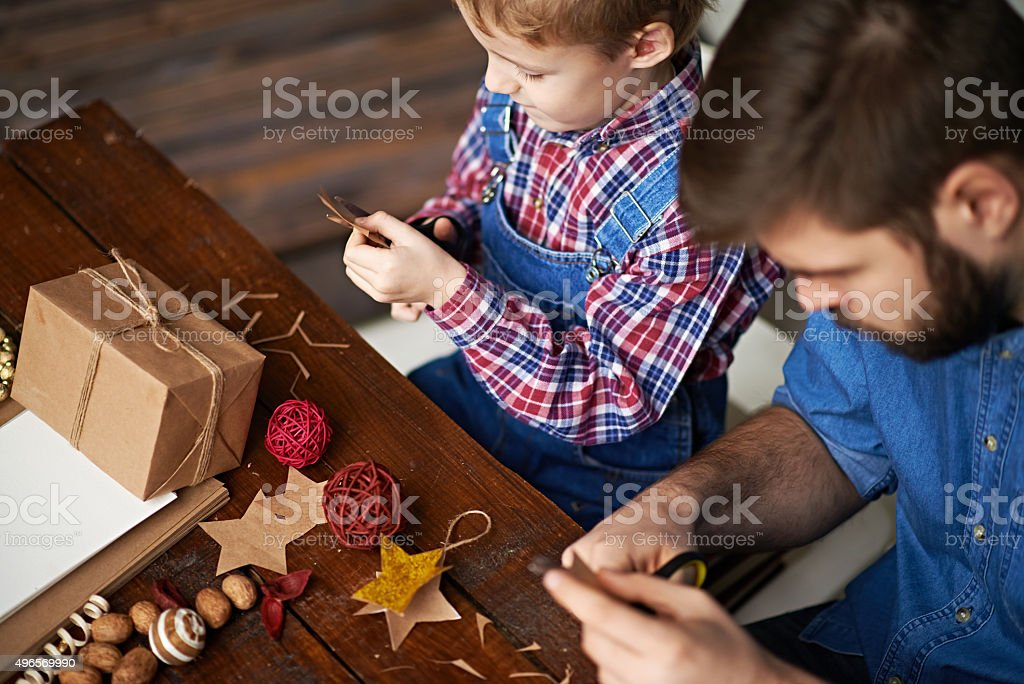 Father and son craft time stock photo