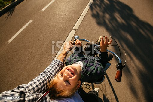 istock Father and son cycling together 491952938
