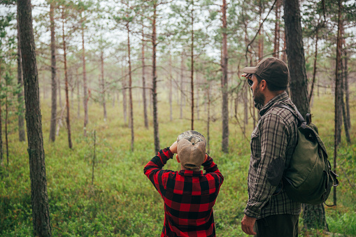 Father and son discovering beauty in nature
