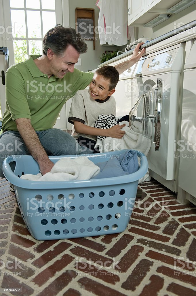 Father and Son doing Laundry Together royalty-free stock photo