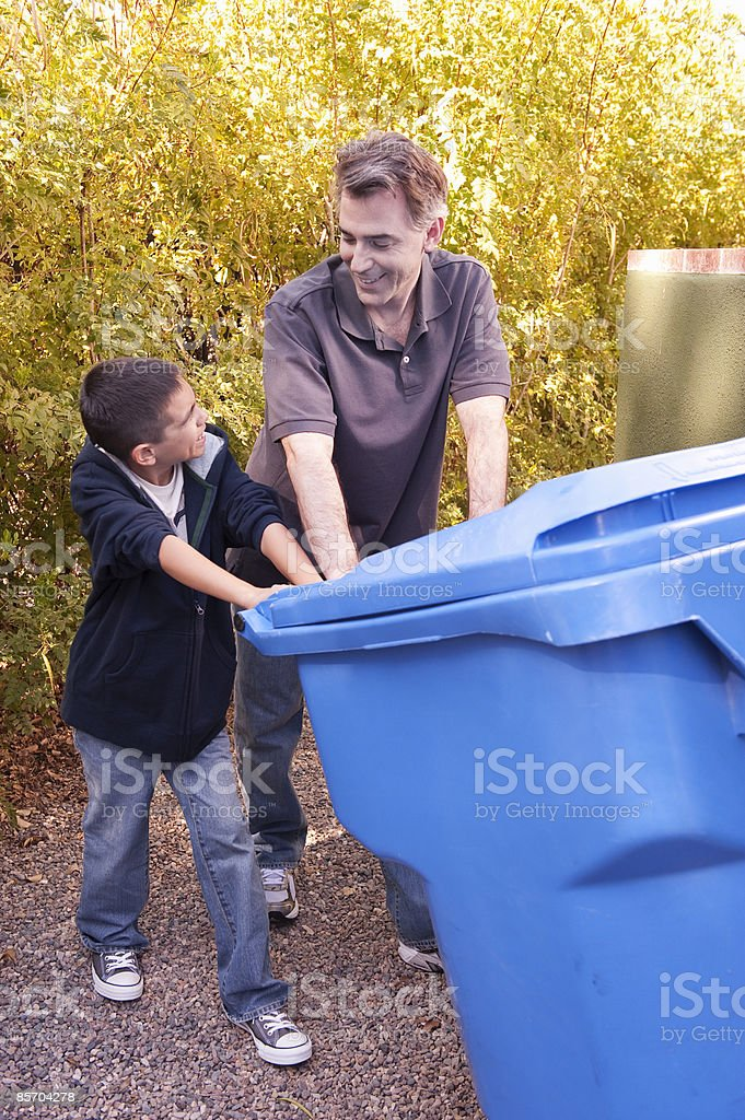 Father and Son doing Recyling at Home royalty-free stock photo