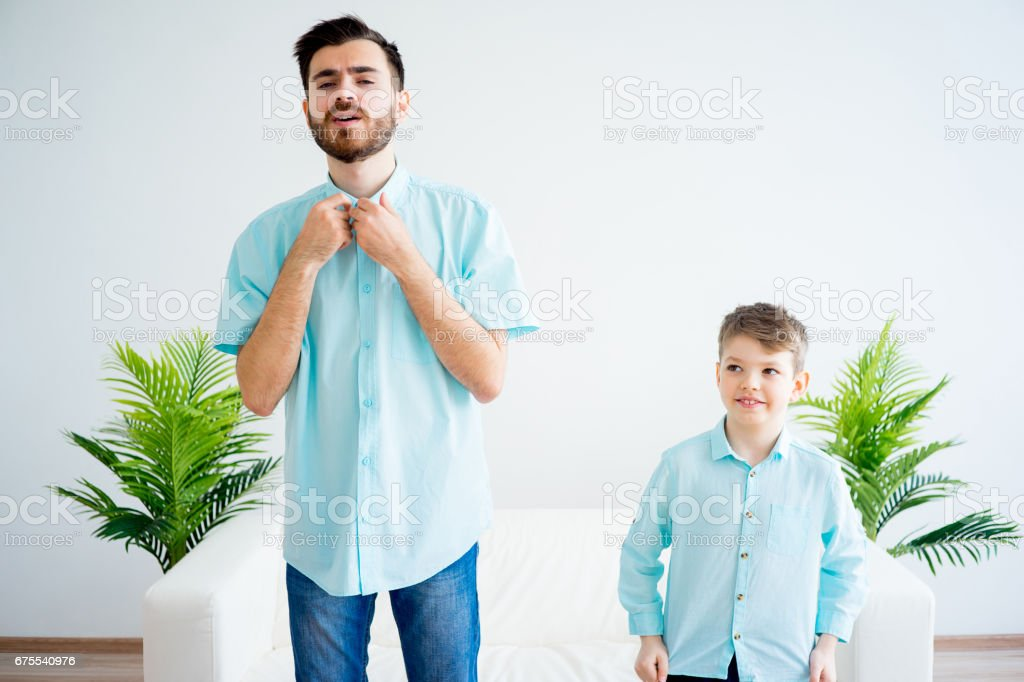 Father and son dress together royalty-free stock photo