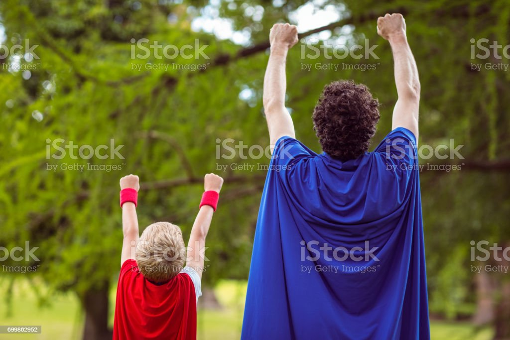 Father and son dressed as superhero stock photo