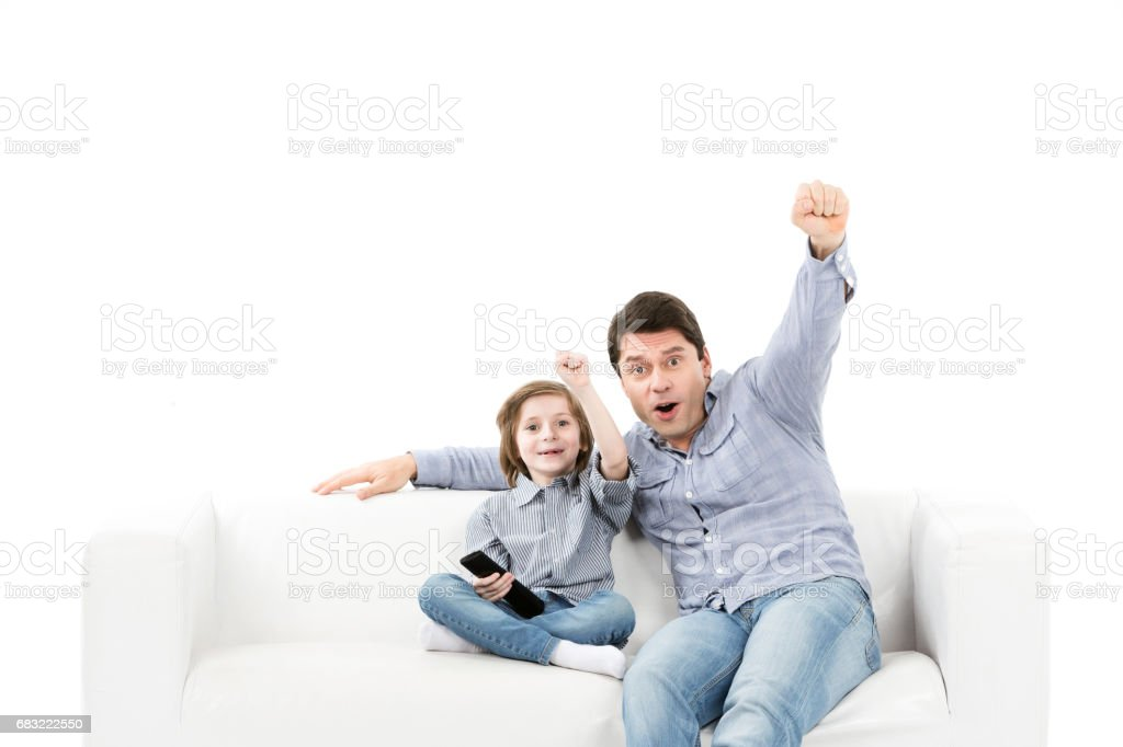 Father and son emotionally watching game in the room. royalty-free 스톡 사진