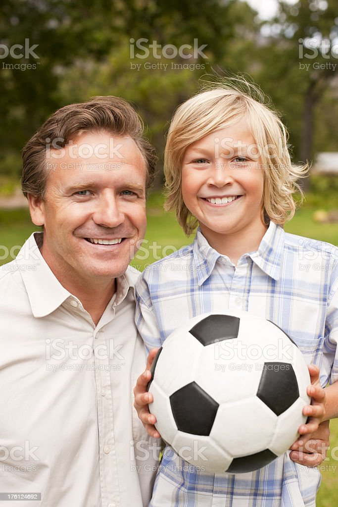 Father and son enjoying at the park royalty-free stock photo