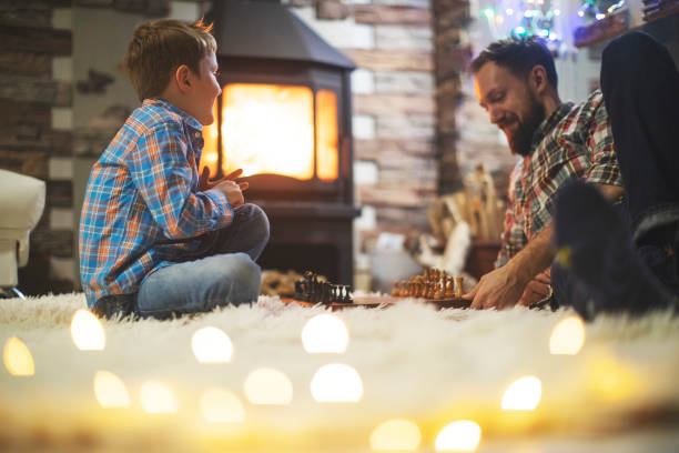 Father and son enjoying Christmas holidays at home stock photo