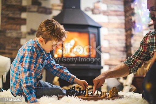 Father and son enjoying Christmas holidays at home