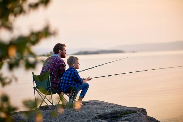 Father and Son Enjoying Fishing Together stock photo