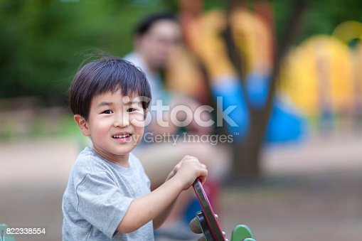istock Father And Son Enjoying In Public Park 822338554
