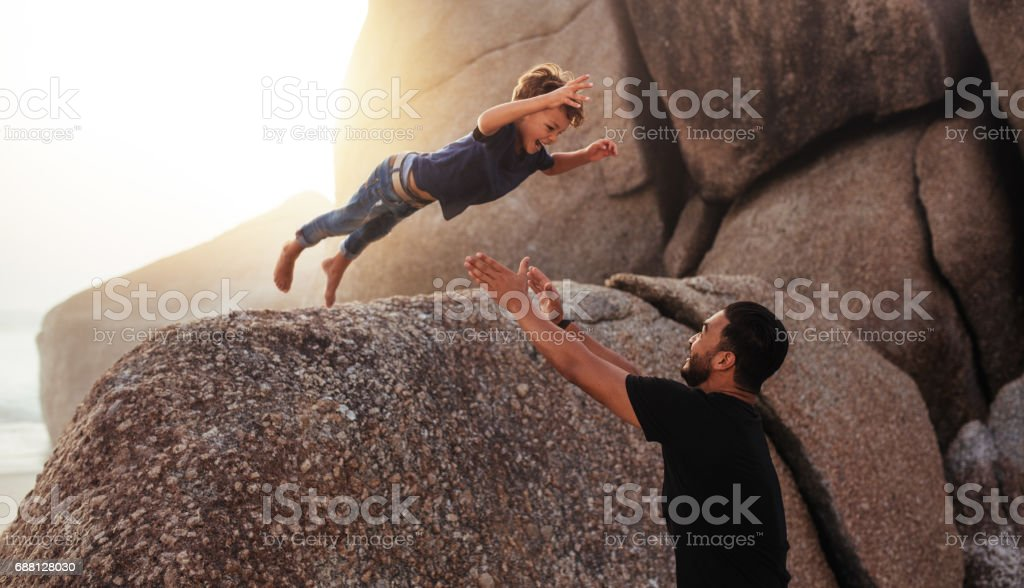 Father and son enjoying summer holidays at the beach stock photo