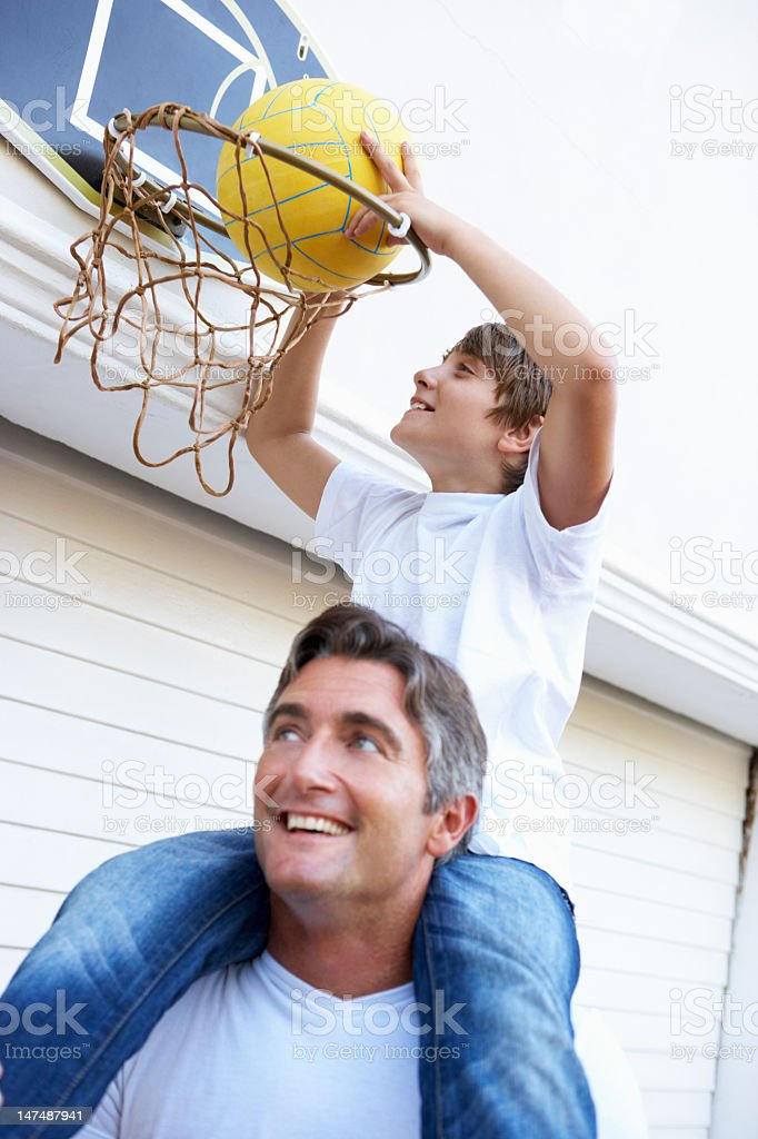 Father And Son Family Playing Basketball Outside Garage royalty-free stock photo