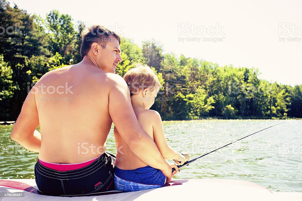 Father and son fishing together royalty-free stock photo