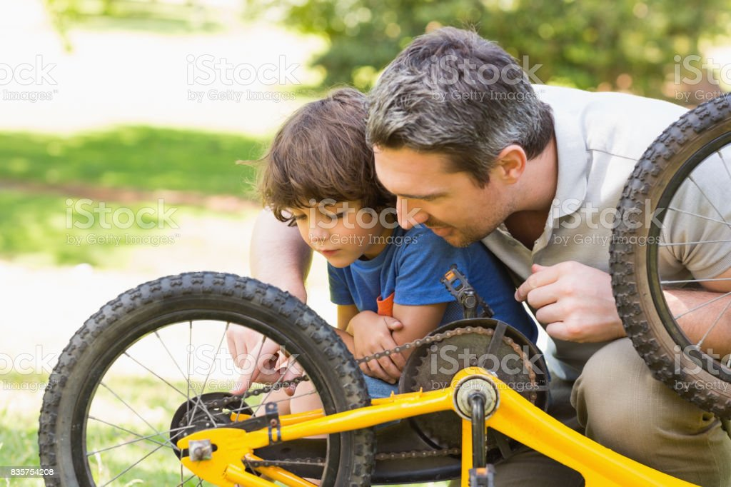 Father and son fixing bike stock photo