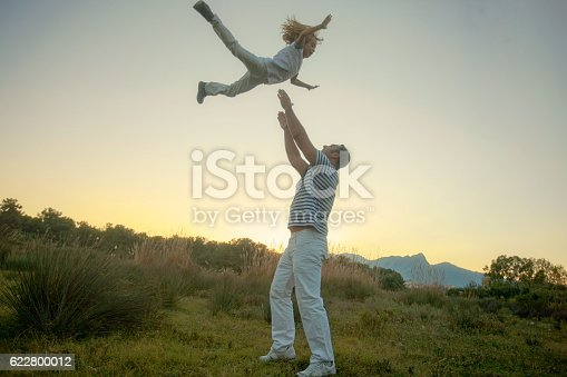 586180632istockphoto father and son fly 622800012