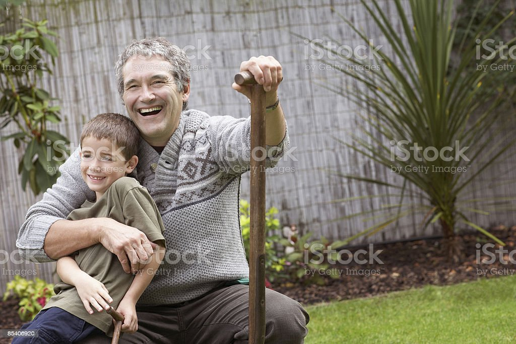 Father and son gardening royalty-free stock photo
